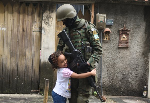 The Soldier and the Child in the Favela City of God. thumbnail