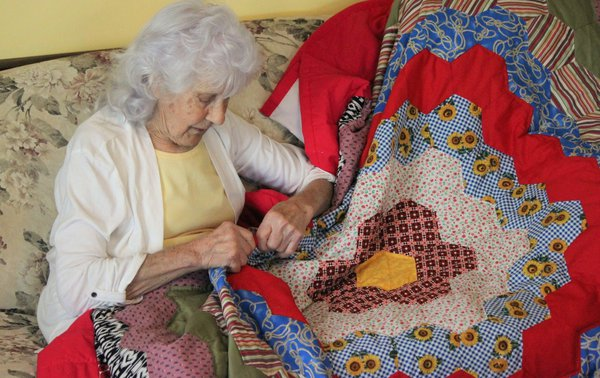 My 85 year old mother-in-law stitching a quilt for my husband. thumbnail