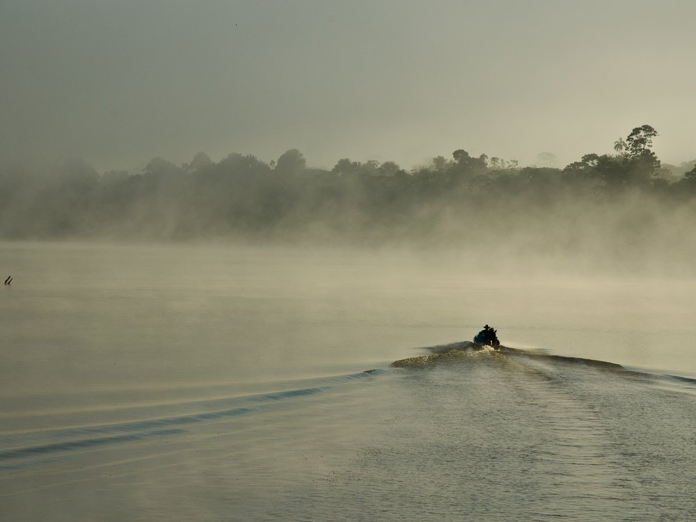 C. David de Santana and his team exploring the Javari River on the border of Brazil and Peru on a misty morning. (Douglas Bastos)