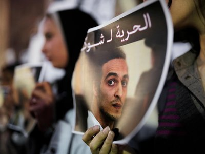 Egyptian journalists hold posters calling for the release from prison detention of Mahmoud Abou Zeid, in front of the Syndicate of Journalists building in Cairo, Egypt, on December 9, 2015.