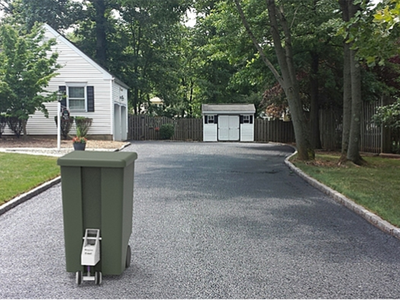 SmartCan is essentially a pair of robotic wheels that are compatible with any municipal-issued trash receptacle.