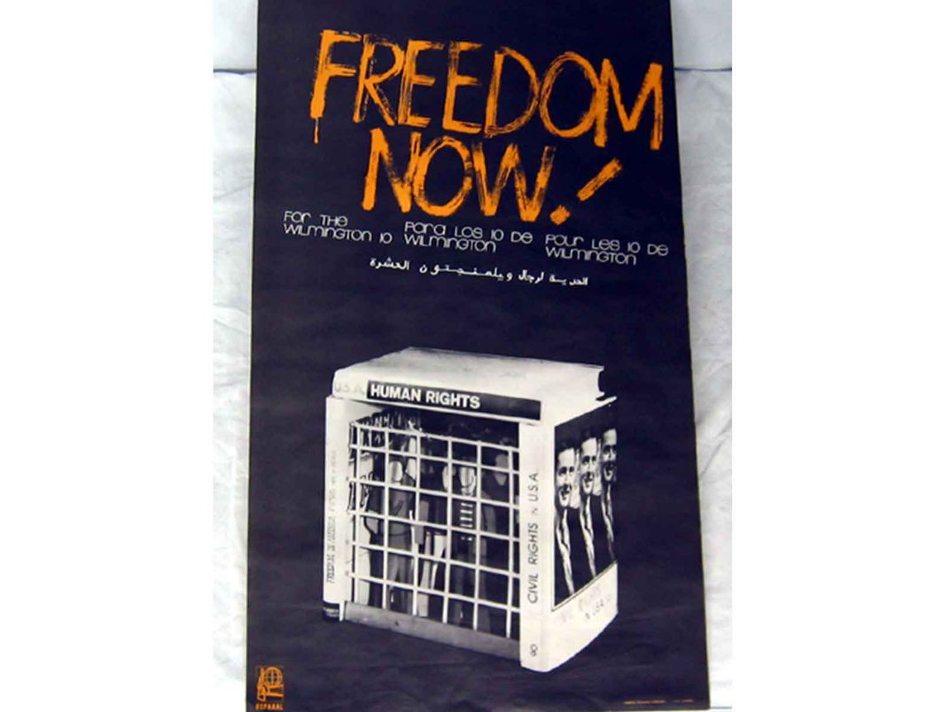 """Black and white vertical poster with an image of a jail cell that reads """"freedom now for the Wilmington 10)"""