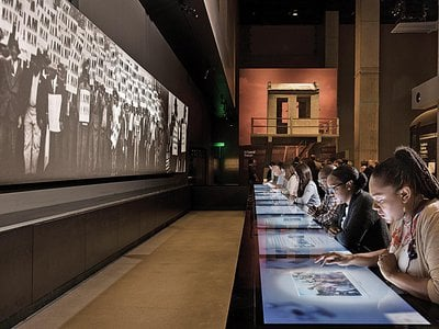 An interactive lunch counter at the African American History Museum lets visitors grapple with moral dilemmas of the civil rights movement.