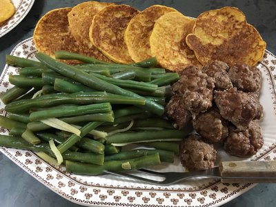 Eighmey's colonial-style corn cakes (top), forcemeat balls (lower right) and pickled French beans (lower left).