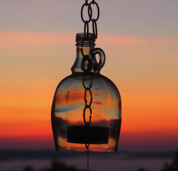 A wind chime refracting the dawn thumbnail