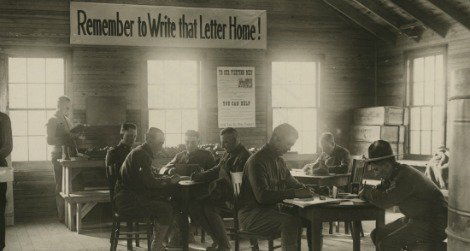 World War I soldiers writing letters home