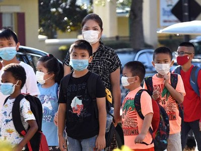 Children head back to school in August even as the Covid-19 delta variant makes its rounds. For reasons that aren't fully understood, kids do not get as sick from Covid-19 as adults do. The role of schools in fostering spread of the virus is also under study.
