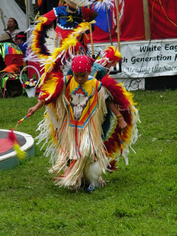 Native American chid feather dancing at a pow wow thumbnail