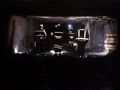 Coal miners walk through a tunnel at the Consol Energy Bailey Mine in Wind Ridge, Pennsylvania in 2013.