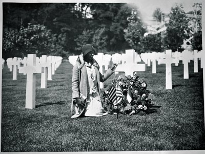 Between 1930 and 1933, the U.S. government funded segregated trips to American military cemeteries in Europe for mothers and widows of fallen soldiers. This Gold Star Pilgrim is visiting a soldier's grave at Suresnes American Cemetery, west of Paris.
