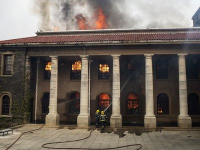 Firefighters work to extinguish a blaze at the University of Cape Town's Jagger Reading Room on April 18.