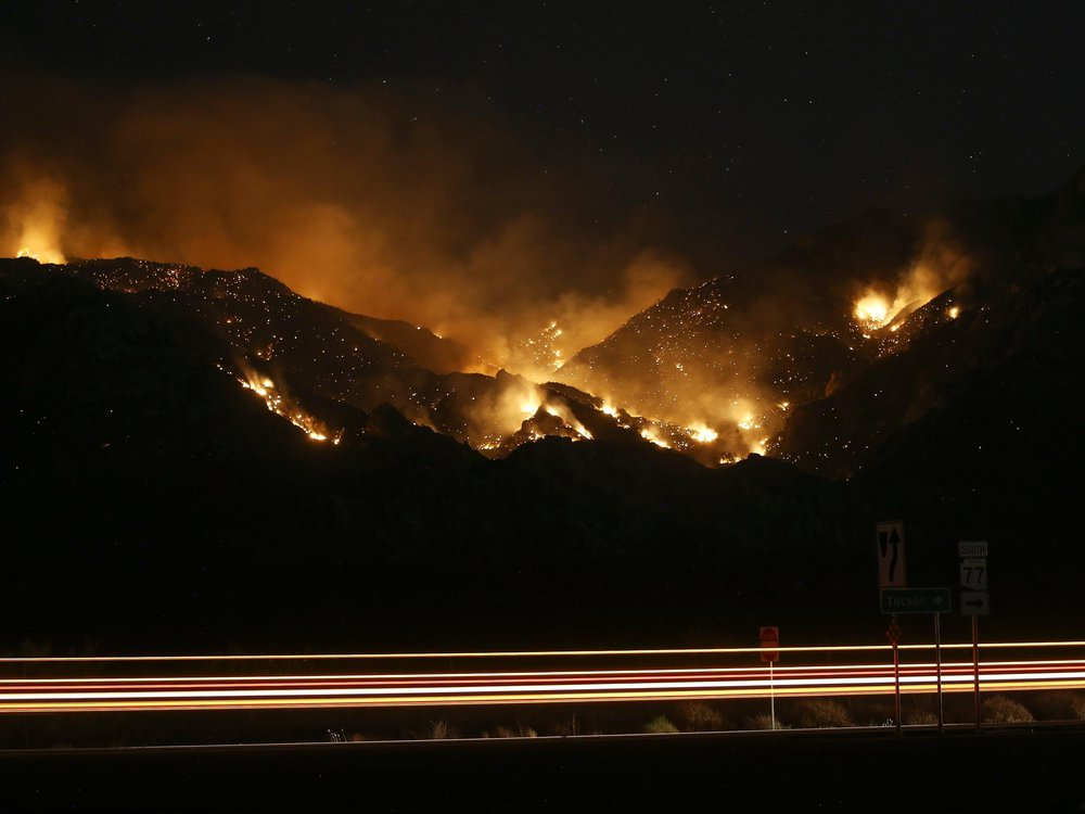 The Bighorn Fire burns through the western side of the Santa Catalina Mountains in Oro Valley, Arizona