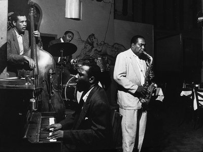 American jazz musicians Charlie Parker, on alto sax, and Thelonious Monk, on piano, perform at the Open Door Cafe, in New York City on September 14, 1953.