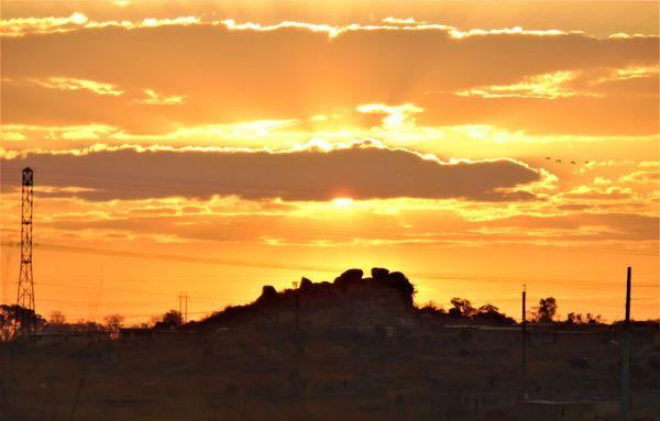 A rare beautiful orange sunset on a kopje in Budiriro, Harare thumbnail