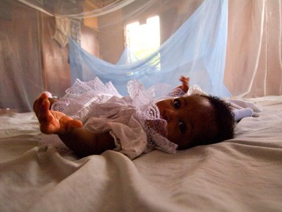 A baby in Ghana rests underneath a mosquito net. Ghana will become one of three African countries to pilot the new malaria vaccine in 2018.