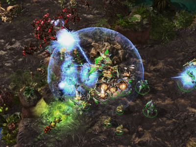 AlphaStar, playing as the StarCraft race Protoss, in green, dealing with flying units from the Zerg players with a combination of powerful anti-air units. The AI program mastered all three races in the game, Protoss, Terran and Zerg.
