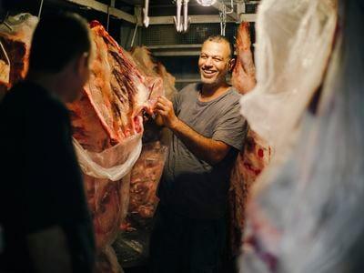 Butcher shop owner Sajad Saleh sells his wares at the Al Tayebat Meat Market.