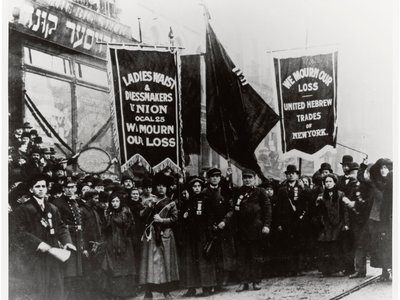 In 1911, demonstrators protested following the tragic Triangle Shirtwaist Factory fire in New York City.