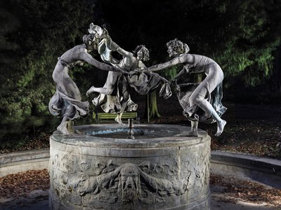 With fingers intertwined and mouths gleefully thrown open, the three maidens dance around the Art Nouveau sculpture by Walter Schott.