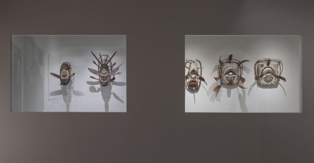 Heard Museum exhibition gallery featuring five Alaska Native masks.