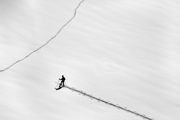 A person cross country skiing on virgin snow thumbnail
