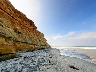Rain, waves, and seeping groundwater can destabilize seaside bluffs, making them prone to collapse.