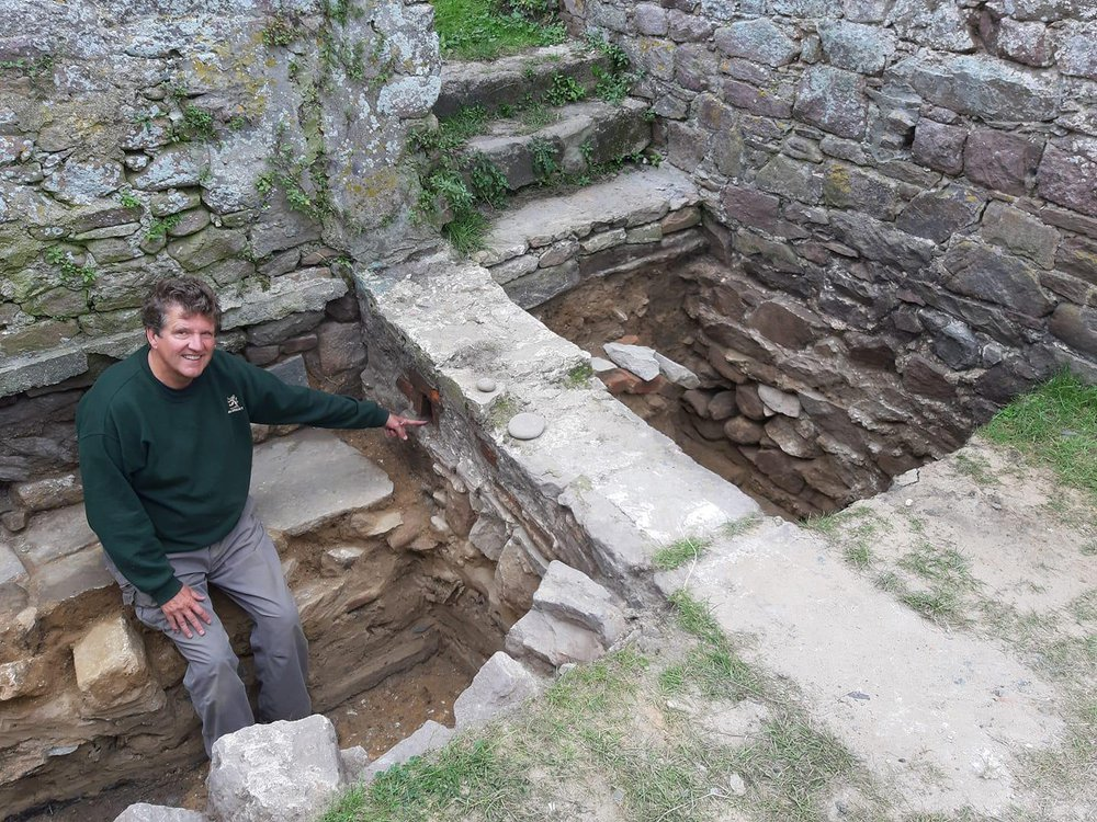 A researcher points to drainage structures at the Nunnery