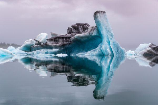 A Large Glacial Iceberg Floats in Bear Glacier Lagoon-- Transformation thumbnail