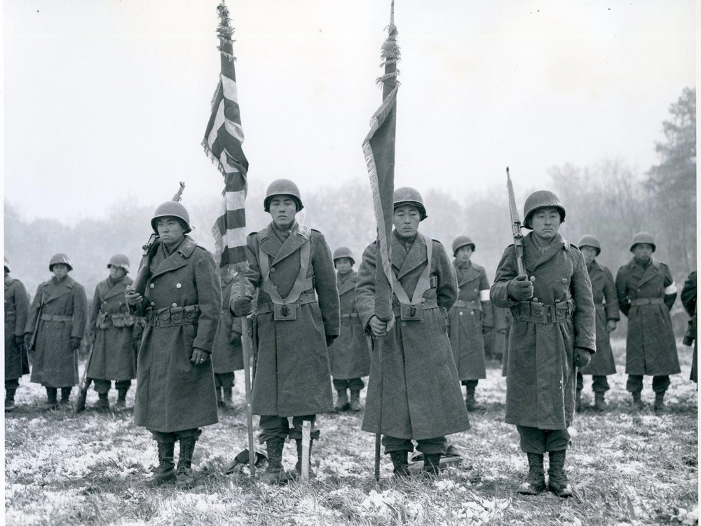 Stunned survivors of the Lost Battalion rescue stand ready for review by General Dahlquist