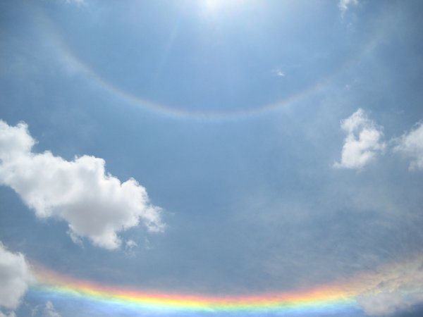 Two rainbows wrap one around the other, 360 degrees around the sun in Salar de Uyuni, Bolivia. thumbnail