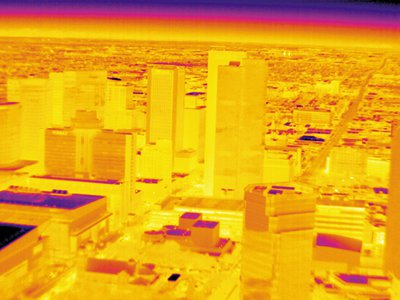 """Phoenix glows even after 10 p.m. one April night in this image made with a camera sensitive to infrared light, which is generated by heat and invisible to the naked eye. Researchers call the city an """"urban heat island."""""""