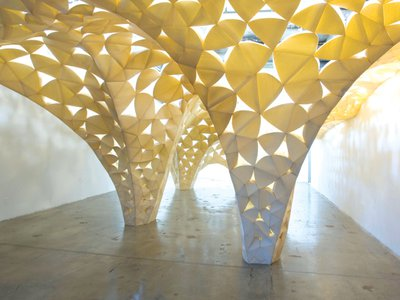 IwamotoScott, Voussoir Cloud, SCIArc Gallery (Los Angeles, California, 2008). PHOTO Judson Terry.  In IwamotoScott Architecture's 2008 installation Voussoir Cloud, heavy wood blocks become translucent petals depending on the changing light of day. The firm won the 2019 National Design Award for Interior Design.