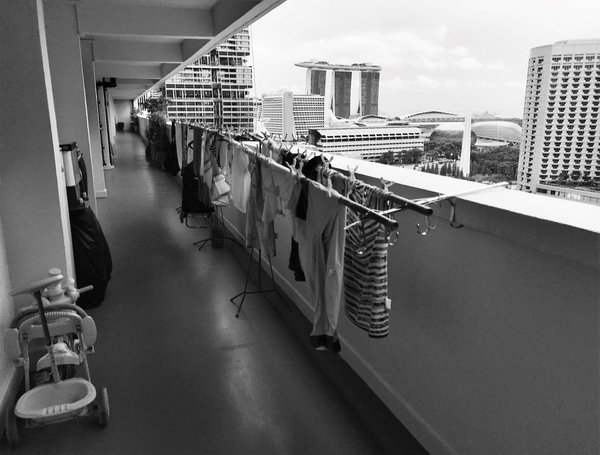 The shared corridor of several public housing units in Singapore thumbnail