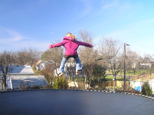 girl in air over trampoline thumbnail