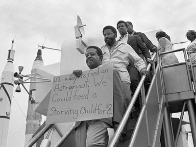 Reverend Ralph Abernathy, Hosea Williams and other members of the SCLC Poor People's Campaign march through the lunar lander exhibit at Kennedy Space Center before the launch of Apollo 11.