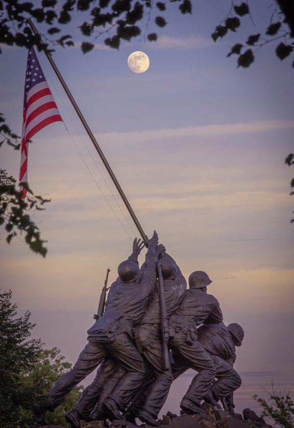 A full moon over the Iwo Jima Memorial during sunset thumbnail