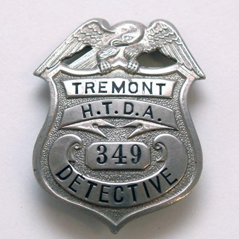 Silver shield-shaped Tremont Detective badge