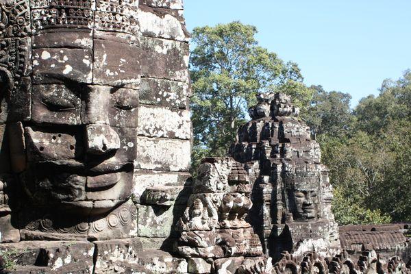Temple faces at Angkor Wat emerge from jungle thumbnail