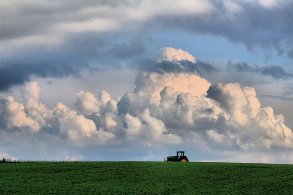 Lone Tractor under cloudscape thumbnail