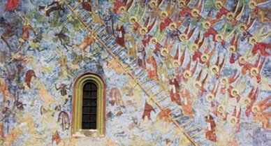 """The Sucevita Monastery was built in the last decades of the 16th century in the Moldavian style, a blend of Byzantine and Gothic art and architecture. The exterior walls' striking frescoes (above, """"The Ladder of Virtues,"""" contrasting the order of heaven with the chaos of hell) still retain their brilliant hues."""