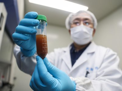 A researcher of Stermirna Therapeutics Co., Ltd. shows the experiment to develop an mRNA vaccine targeting the novel coronavirus in east China's Shanghai.