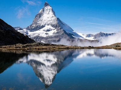 The Matterhorn is perhaps the most recognizable of the peaks that make up the Alps, and has a height of 14,692 feet.