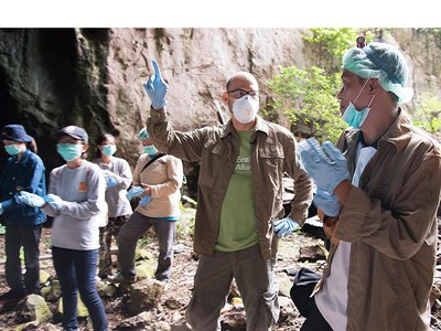 Dr. Kevin Olival and the USAID PREDICT wildlife team surveying areas for bat trapping at the entrance to a cave in Thailand.