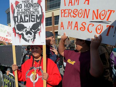 People protest against the name of the Washington, D.C., NFL team before a game between Washington and the Minnesota Vikings. Minneapolis, November 2, 2014.