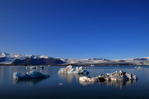 Icebergs Under the Blue Sky thumbnail