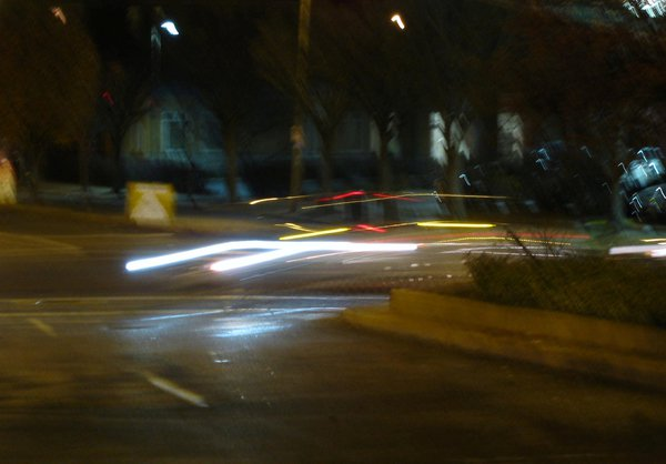 Lights of car making a left turn in an intersection. thumbnail