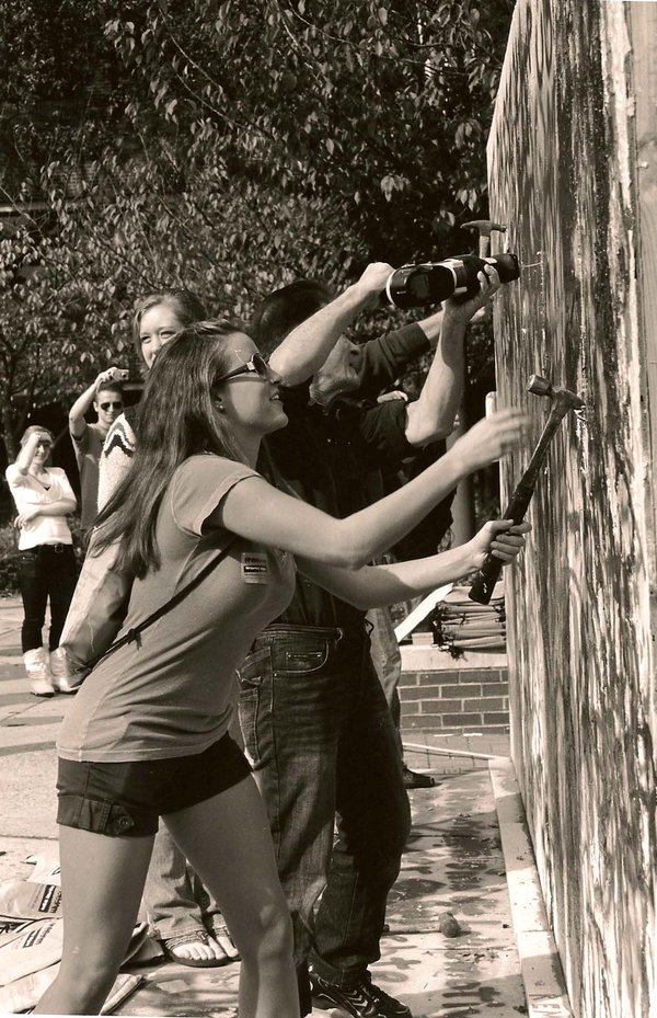 Student tearing down the campus built Berlin Wall to celebrate anniversary of its falling thumbnail