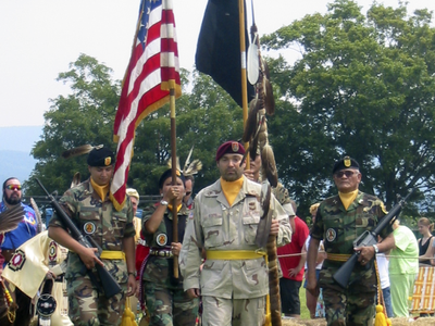On mid-tour leave from Operation Iraqi Freedom, Sergeant First Class Chuck Boers carries in the eagle staff at the Shenandoah Powwow, 2004. (Courtesy of Chuck Boers)