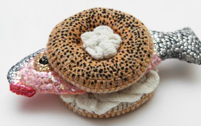 Designer Kate Jenkins goes for a mix of realism and humor in her crocheted works of art. Here, the poppy seed bagel looks quite delectable until you notice the lips on that lox.