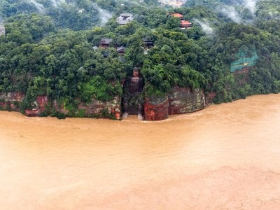 On August 18, 2020, flood waters threatened the Leshan Giant Buddha following heavy rains in Leshan in China's southwestern Sichuan province, where thousands of residents have been displaced by rising waters.